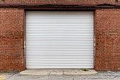 """istock brick wall warehouse receiving door alley""""n 1202104005"""