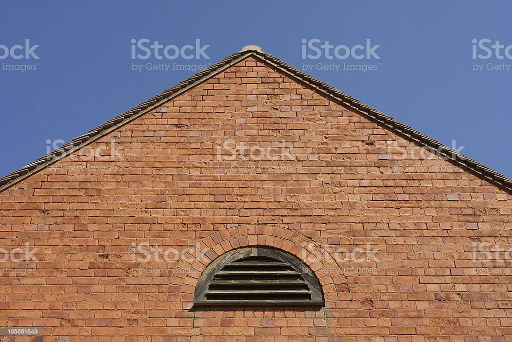 Brick Wall With A Pitched Roof Stock Photo Download Image Now