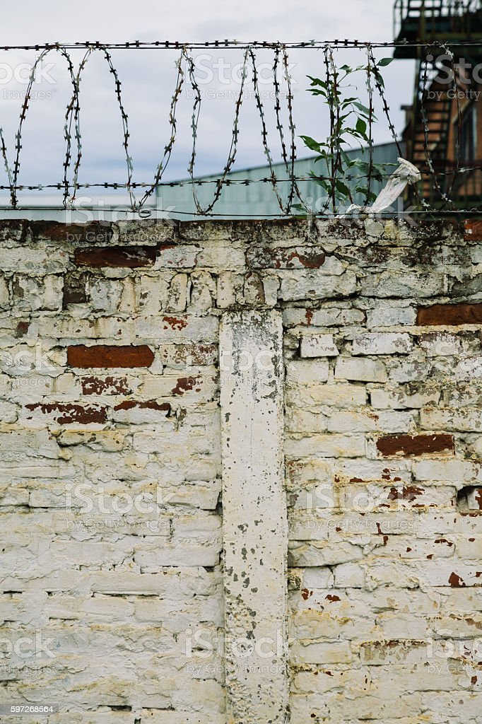 Brick wall with barbed-wire royalty-free stock photo
