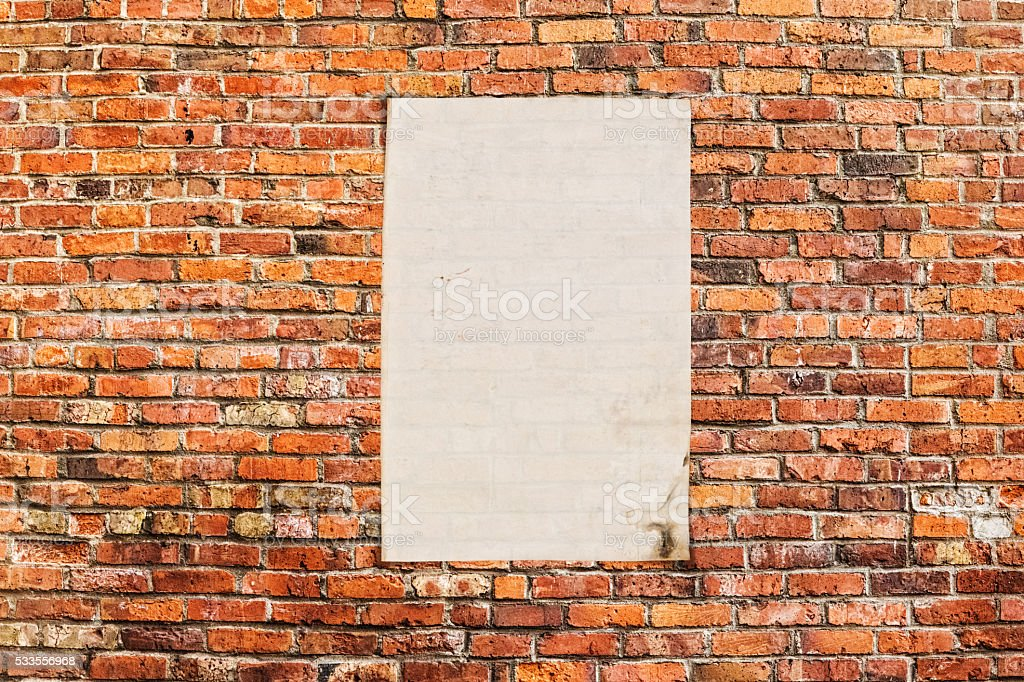 Brick Wall with Blank Poster stock photo