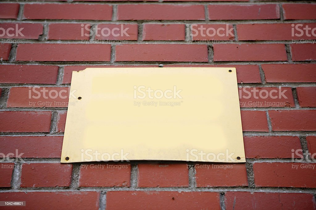 Brick wall with blank sign royalty-free stock photo