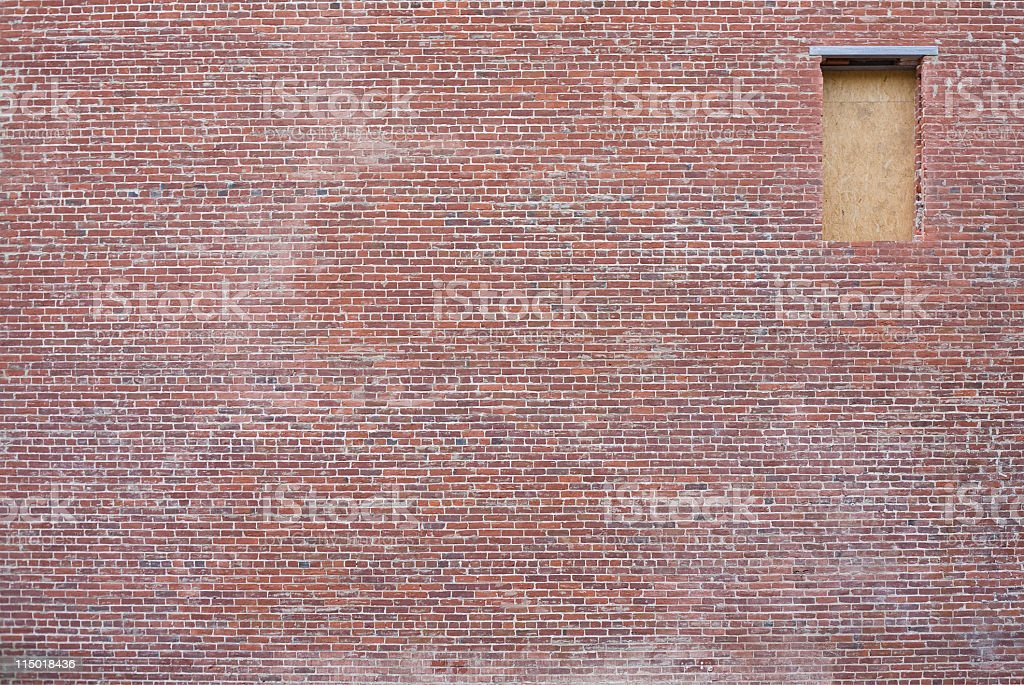 Brick Wall With Boarded Up Window royalty-free stock photo