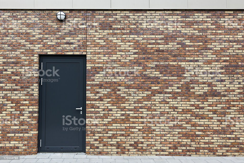 Brick wall with door royalty-free stock photo