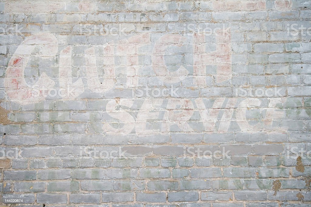 Brick Wall with Layers of Lettering Clutch Repair royalty-free stock photo