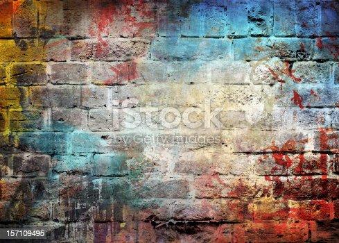 Brick wall with graffiti paint