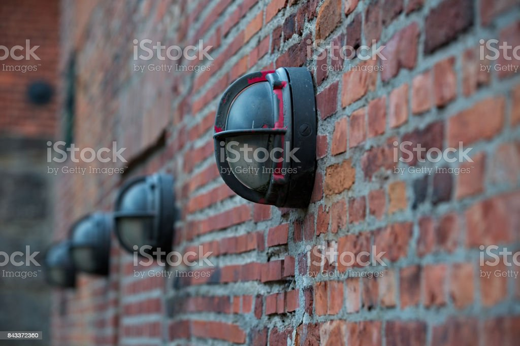 Brick wall with luminaires stock photo