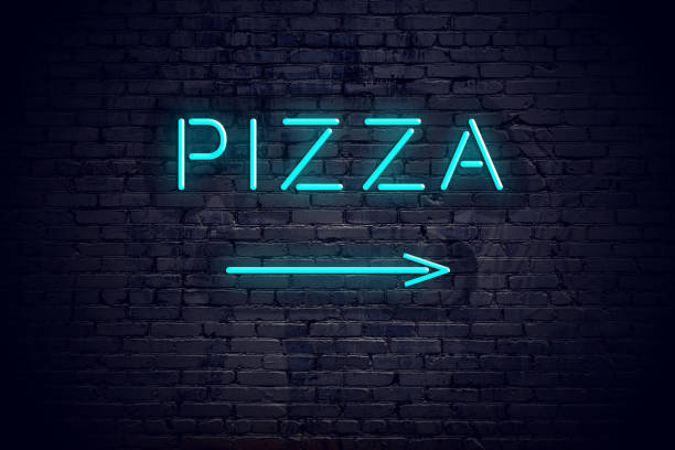 Brick wall with neon arrow and sign pizza