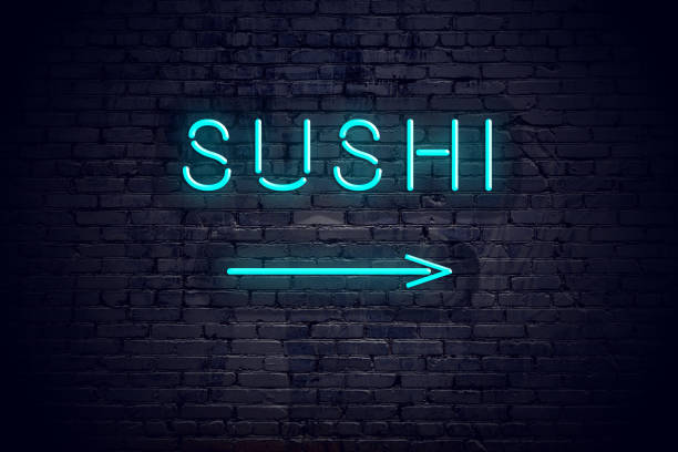 Brick wall with neon arrow and sign sushi