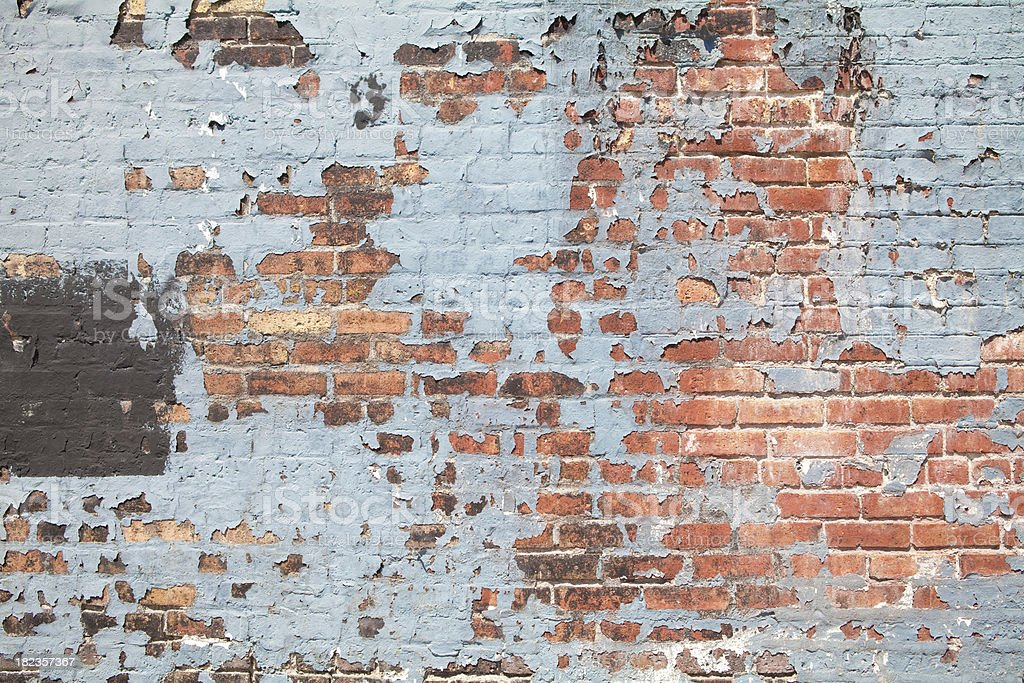 Brick Wall with Peeling Paint stock photo