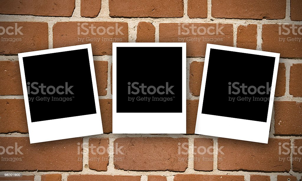 Brick wall with Photos royalty-free stock photo