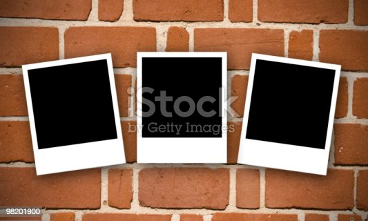 Brick Wall With Photos Stock Photo & More Pictures of Blank