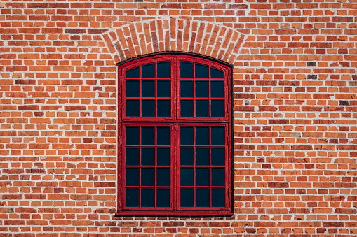 Brick wall with red window