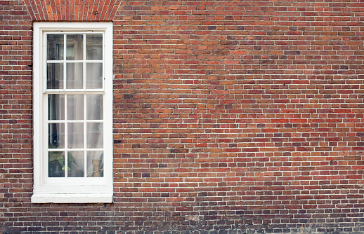 Brick wall with window and copy space