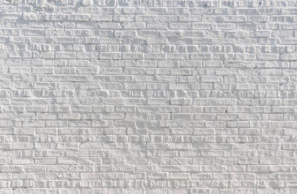Pared de ladrillo blanco de pintadas - foto de stock