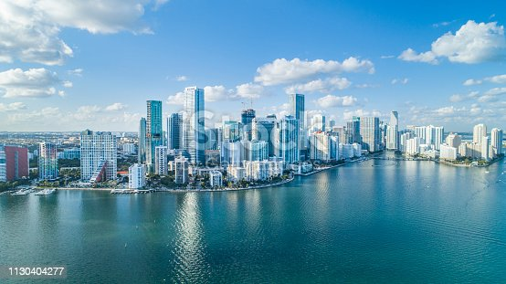 An aerial shot of Brickell Key, with downtown cityscape.