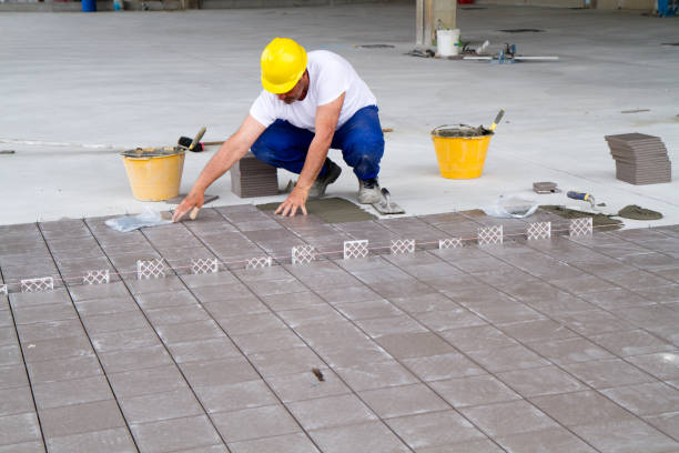 bricklayer at work in building site stock photo