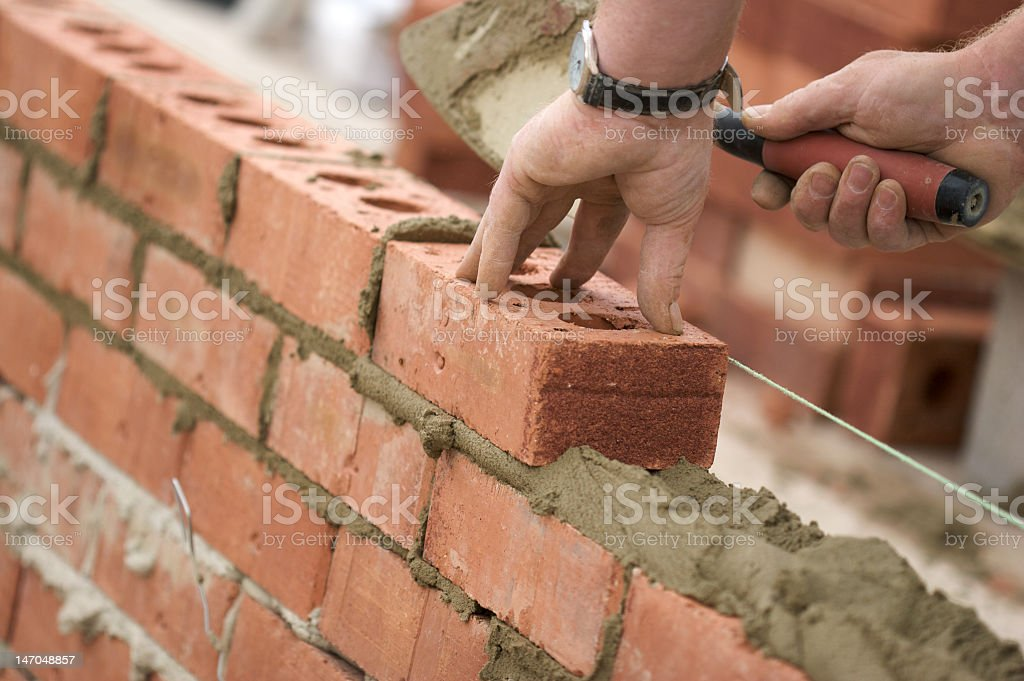 Bricklayer building wall royalty-free stock photo