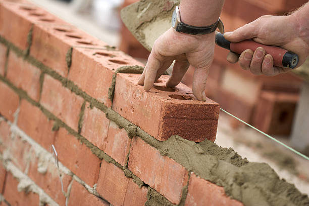 Bricklayer building wall stock photo