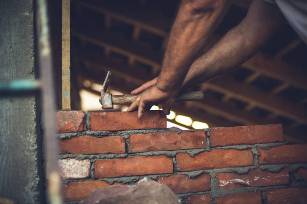 Bricklayer builds a new house,mason at work stock photo