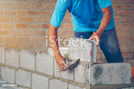 istock bricklayer - Construction of new home renovation 844113644