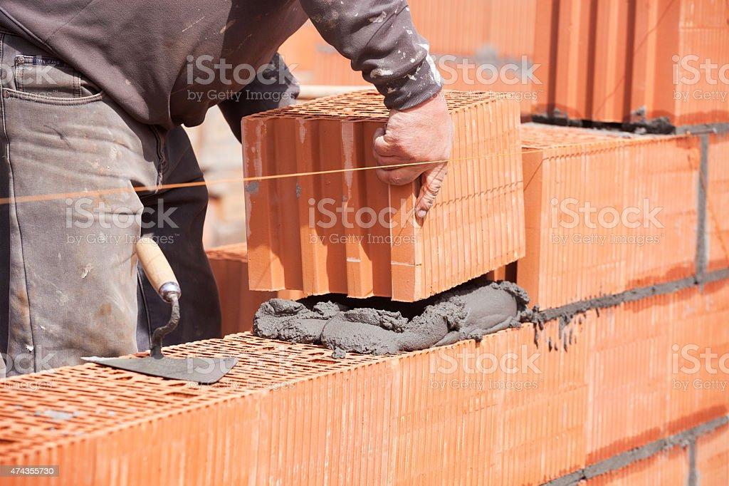 Bricklayer in work stock photo