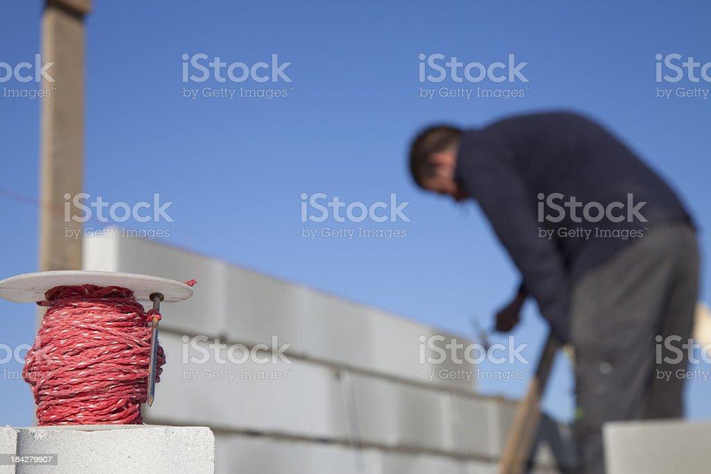 Bricklayer laying bricks. royalty-free stock photo