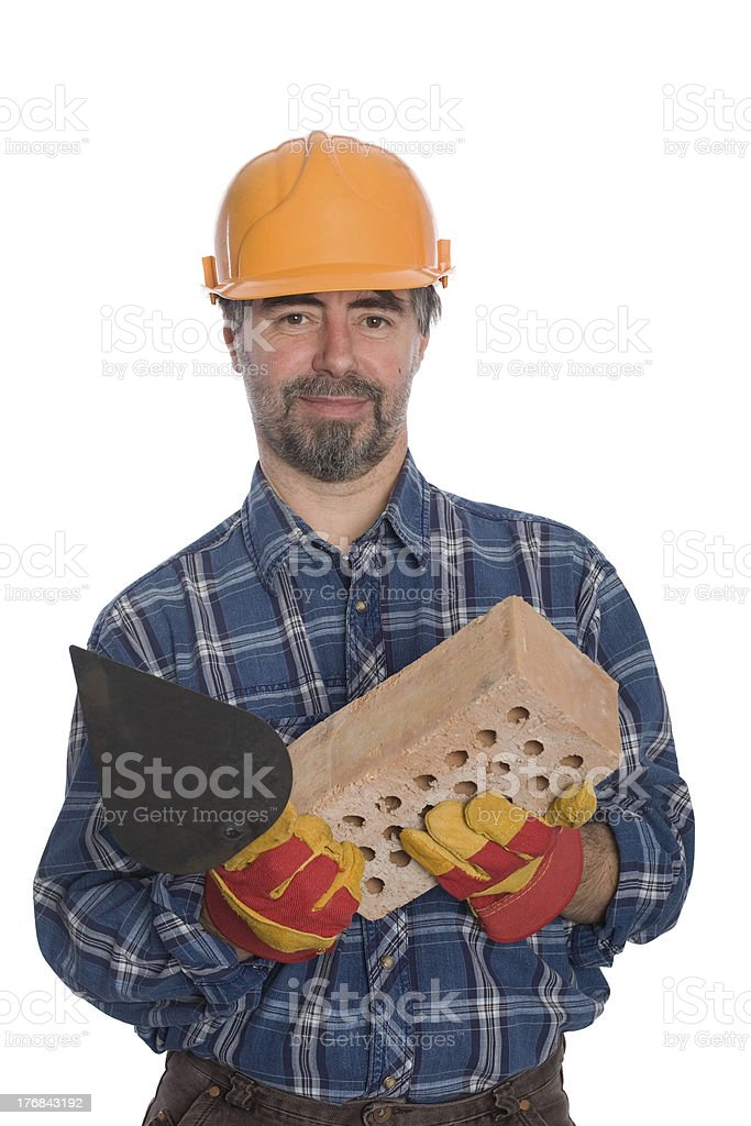 Bricklayer with trowel and brick royalty-free stock photo