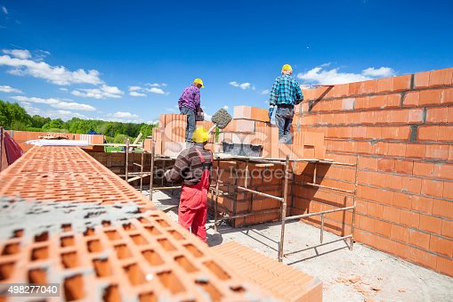 Bricklayers on building