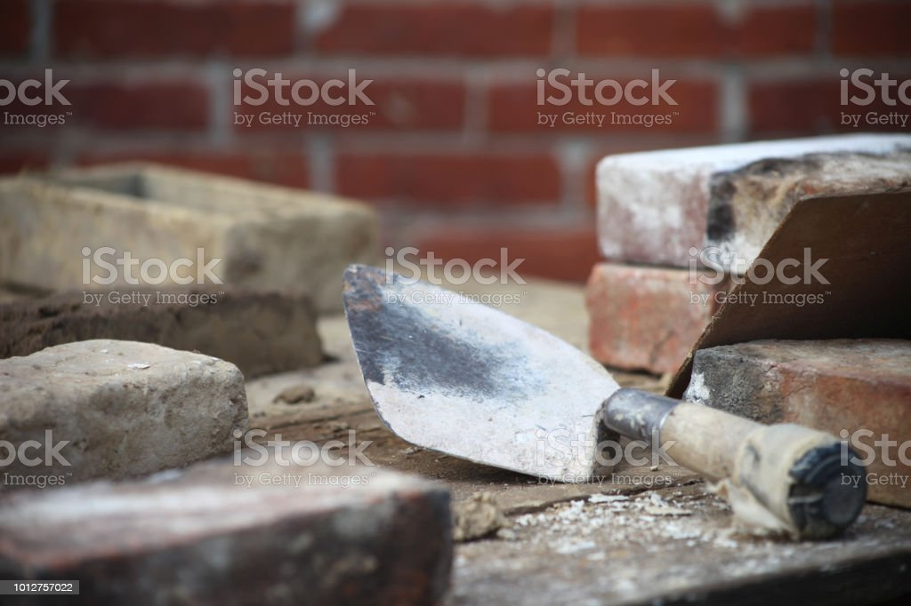 Bricklaying scene with trowel and bricks stock photo
