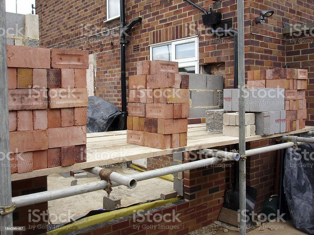bricks on scaffolding for wall construction royalty-free stock photo