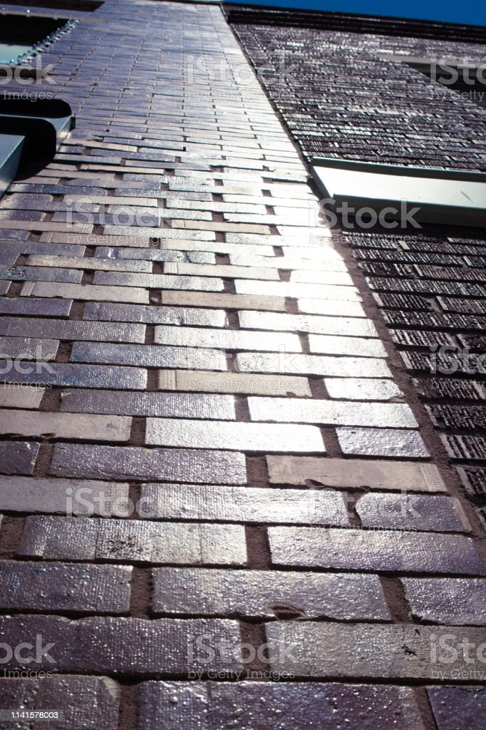 Bricks run up the side of a building stock photo