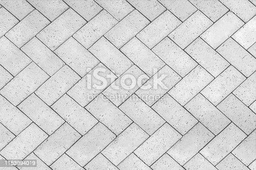 Bricks tiled floor with zigzag pattern texture background.