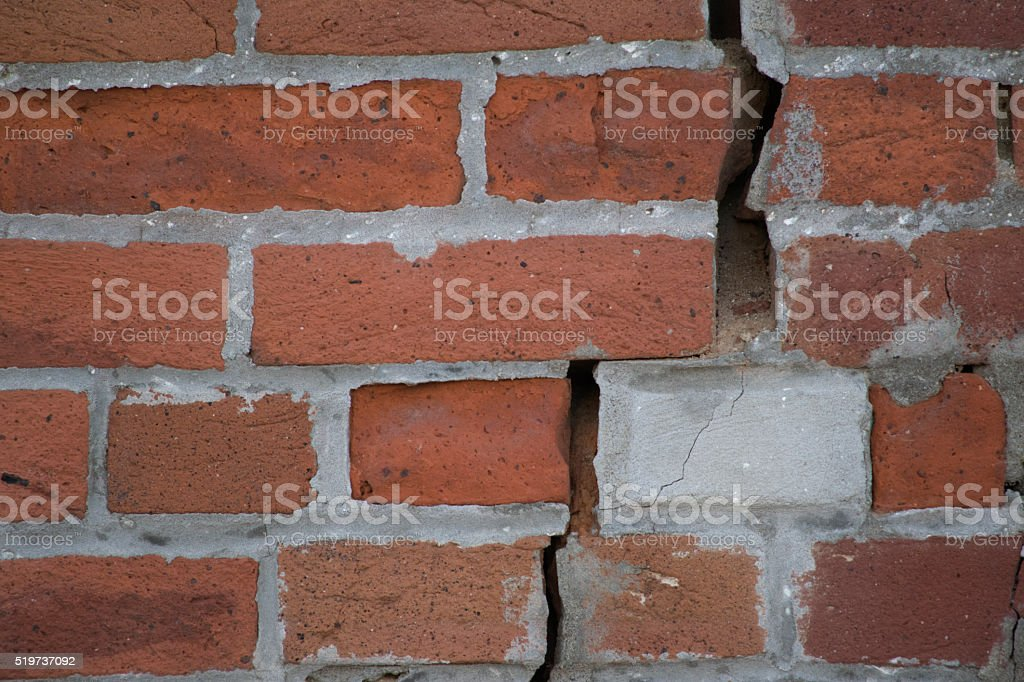 Bricks with crumbling mortar stock photo