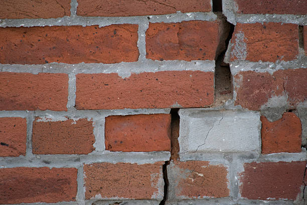 bricks with crumbling mortar - dept stock pictures, royalty-free photos & images