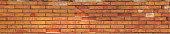Panoramic shot. Texture of red brick. Old brick wall.