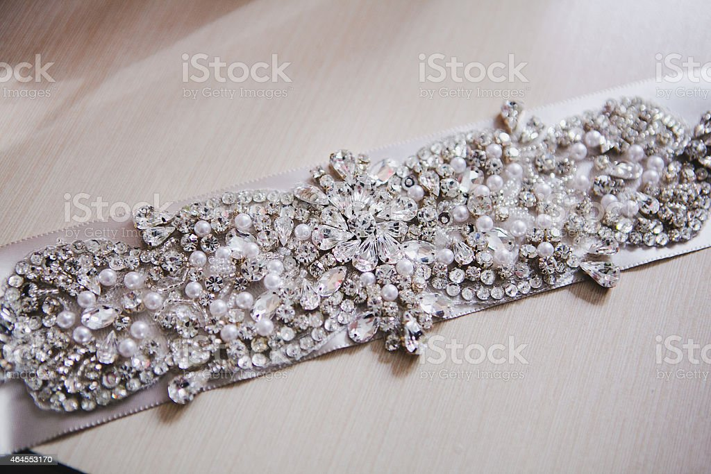 belt with rhinestones on a luxurious white wedding dress