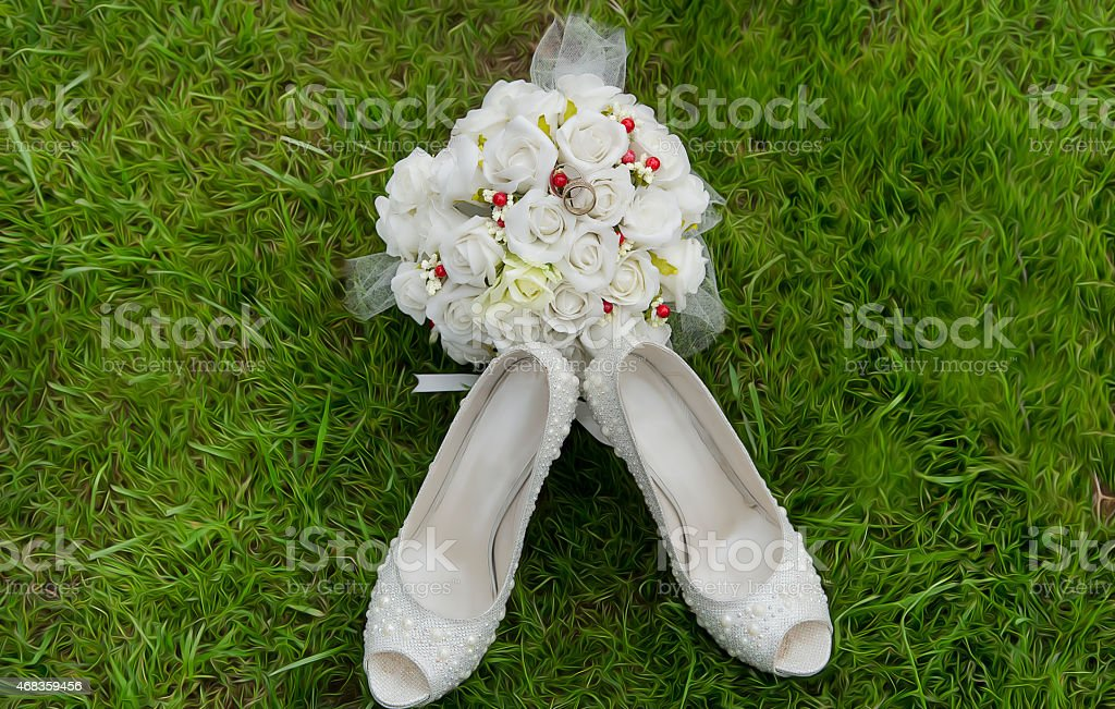 bridal bouquet and shoes royalty-free stock photo