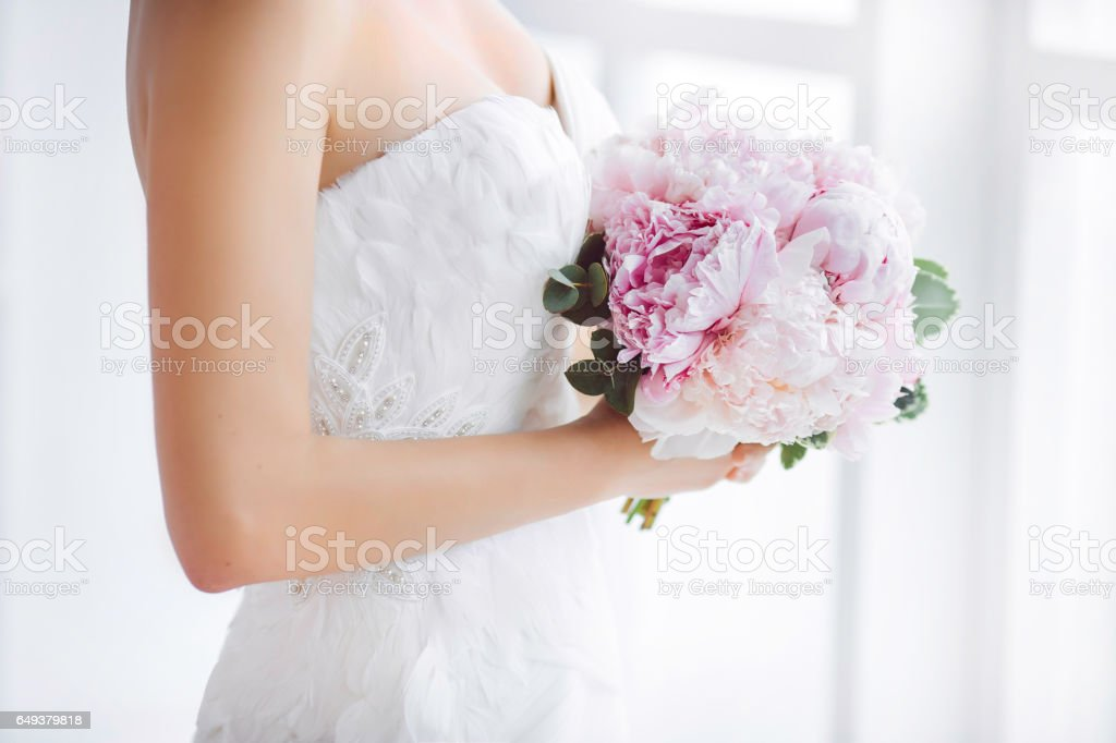 Bridal bouquet Beautiful of pink wedding flowers in hands of the bride stock photo