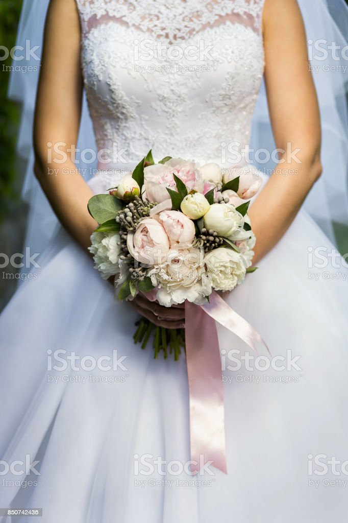 bridal bouquet in hands of the bride, bridal accessories, wedding...