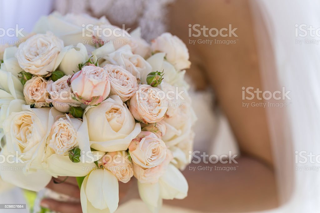 bridal bouquet of roses and tulips stock photo