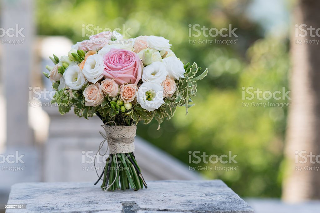 bridal bouquet of roses, freesia, eustoma stock photo