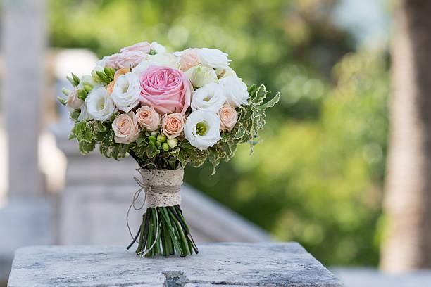 bridal bouquet of roses, freesia, eustoma stock photo