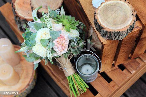 istock Bridal bouquet of roses on a wooden planks 665571274