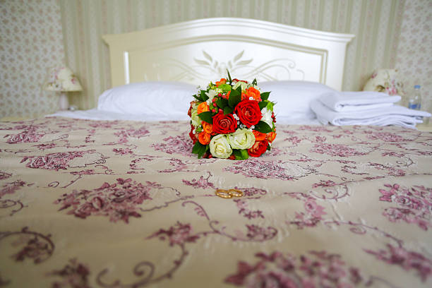 Bridal Bouquet on a bed stock photo