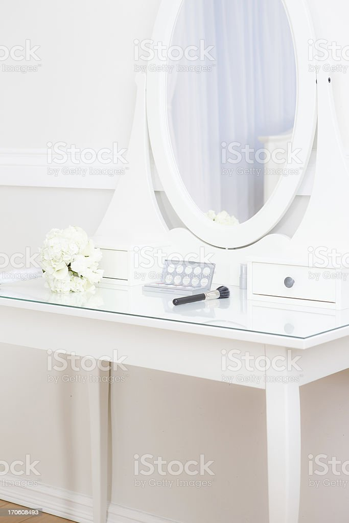 Bridal bouquet on makeup table stock photo