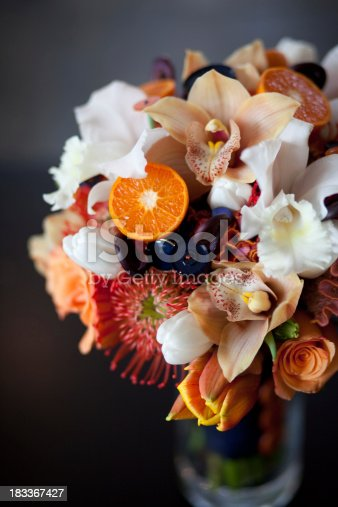 A floral arrangement for a wedding in a vase.