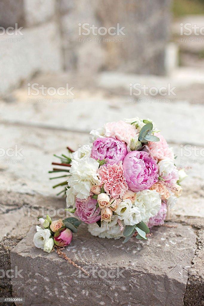 A bridal bouquet sitting on bricks stock photo