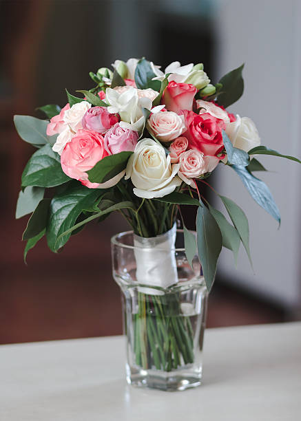 Bridal bouquet standing in a glass on a wooden table picture id538802306?b=1&k=6&m=538802306&s=612x612&w=0&h=y3 se2hdcq lq6vnhrqyvczetdsrynrtryp1itkwgji=
