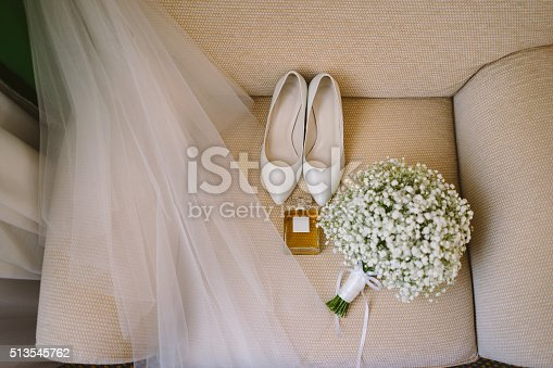 istock bridal bouquet, white shoes, perfume and veil 513545762