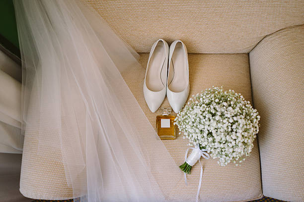 bridal bouquet, white shoes, perfume and veil - veil stock pictures, royalty-free photos & images